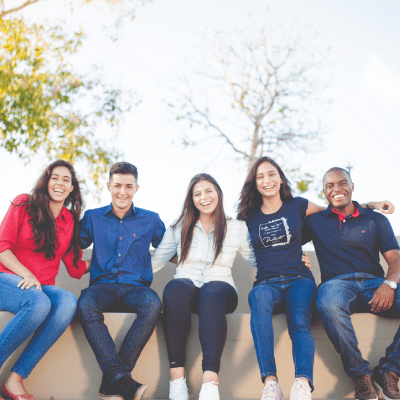 A group of students sitting on a wall